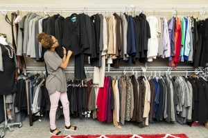 Student looking at row of clothes in Crimson Career Closet