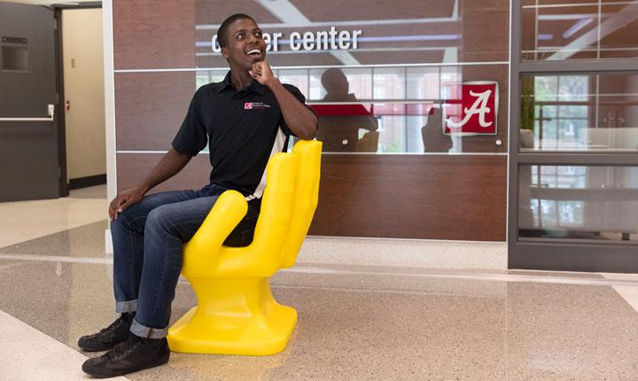 Peer Advisor in Hand Chair