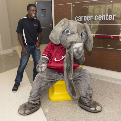 Handshake hand chair with Big Al and Career Center student staff
